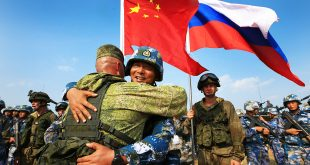 ZHANJIANG, Sept. 14, 2016 (Xinhua) -- Chinese and Russian marines hug during a joint naval drill in Zhanjiang, south China's Guangdong Province, Sept. 14, 2016. China and Russia started ''Joint Sea 2016'' drill off Guangdong Province in the South China Sea on Tuesday. The drill will run until Sept. 19, featuring navy surface ships, submarines, fixed-wing aircraft, helicopters, marines and amphibious armored equipment. (Xinhua/Zha Chunming) (wyo) (Credit Image: © Zha Chunming/Xinhua via ZUMA Wire)